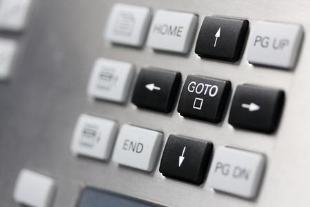 function key: Close up of control panel keypad. Cursor keys buttons. Selective focus on GOTO key.