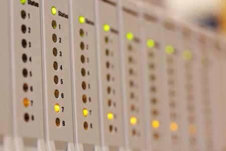 PLC programmable logic controller inputoutput modules installed in a rack. Selective focus.
