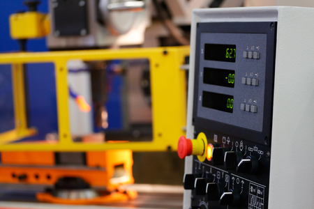 Vertical CNC machining center with control panel on the foreground. Stock Photo