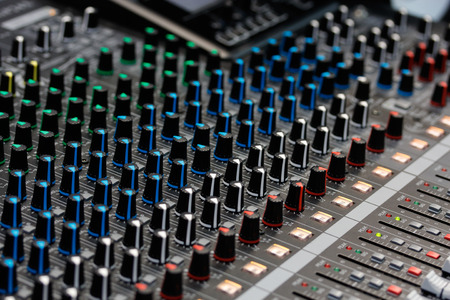 master volume: Close up view of sound mixing console. Selective focus. Stock Photo