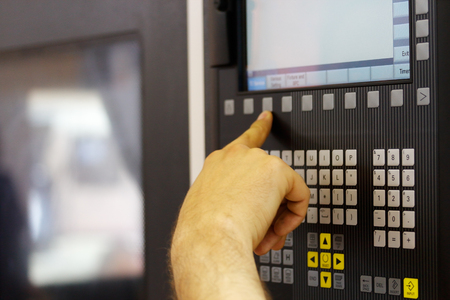 function key: Operator working with cnc machine.Selective focus.