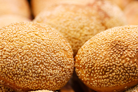 Close up of buns with sesame seeds. Selective focus. Standard-Bild