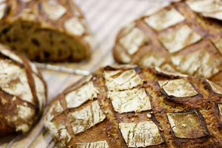 Closeup of fresh baked brown bread. Selective focus. Standard-Bild