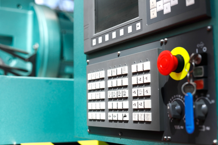 Control panel of modern metalworking cnc machine center. Selective focus.