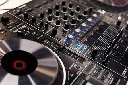 Close up of professional dj controller. Selective focus. Standard-Bild