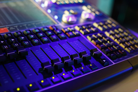 Compact lighting control console for music shows and concerts. Selective focus. Stock Photo