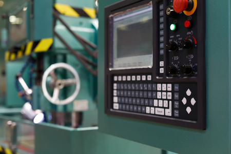 Control panel of the CNC metalworking machine. Selective focus.