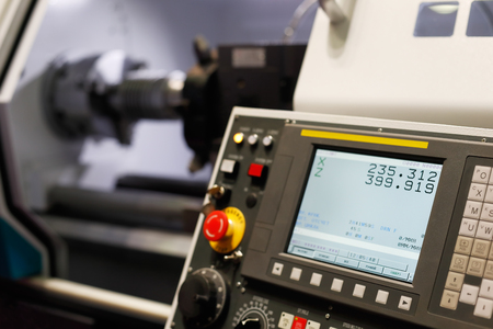 Control panel of the lathe machine with computer numerical control (CNC). Selective focus