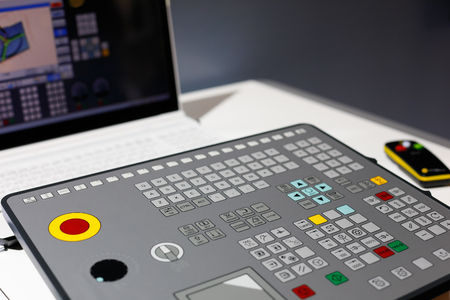 CNC training console simulates real control panel of CNC machine and makes the learning process more realistic. Selective focus.