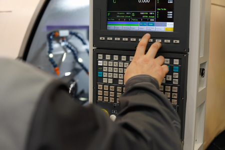 CNC operator programming lathe machine. Selective focus. Standard-Bild