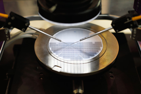 Semiconductor silicon wafer undergoing probe testing. Selective focus. Stok Fotoğraf - 91517081