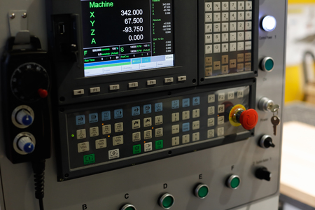 Control panel of the CNC machine. Selective focus.