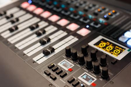 Close up view of multichannel digital audio mixing console. Selective focus. Standard-Bild