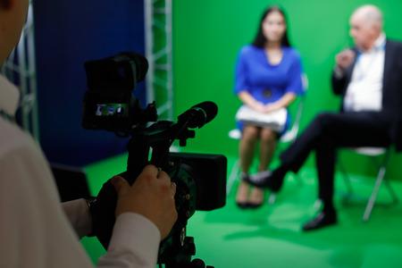 Video recording of an interview in tv green screen studio. Selective focus.