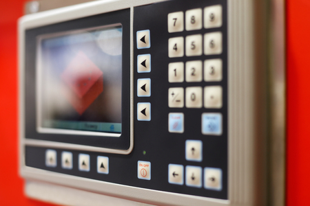 Control panel of the computer-aided manufacturing equipment. Selective focus. Standard-Bild