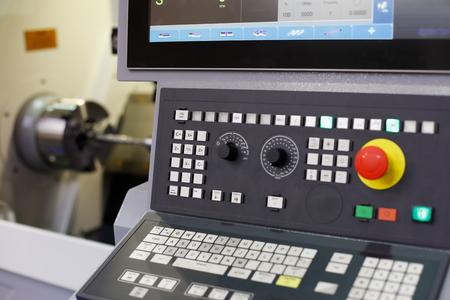 CNC lathe machine with a control panel. Selective focus. Standard-Bild - 110892189
