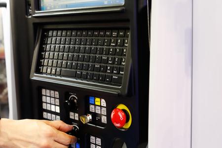 Operator working with CNC lathe machine using control panel. Selective focus. Standard-Bild - 110892191