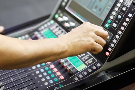 Sound engineer working with audio mixer during concert performance. Standard-Bild - 118983350