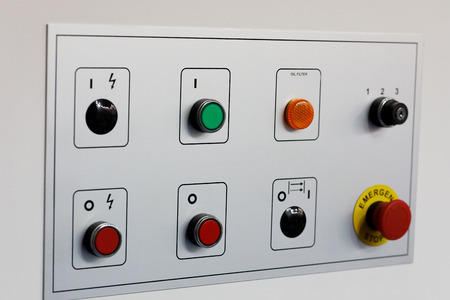 Control panel of industrial equipment with pushbuttons. Standard-Bild - 118983451