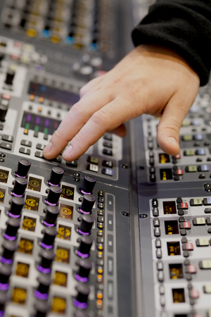 Sound engineer working on music mixer console in the recording studio. Selective focus. Standard-Bild - 118983453