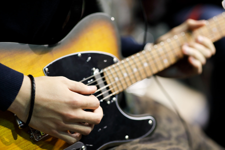 Male guitarist playing electric guitar. Close up. Selective focus. Standard-Bild - 118983641