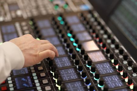 Sound engineer works on modern digital audio mixer at recording studio. Standard-Bild - 118983725