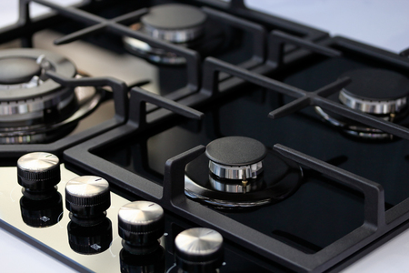 Modern auto ignition gas stove with four burners. Selective focus. Standard-Bild - 118984546