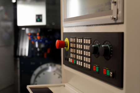 CNC machining center with a control panel in the foreground. Selective focus. Standard-Bild - 118984563