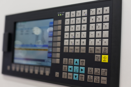 Control panel and screen of CNC-operated machine. Selective focus. Standard-Bild - 118984601