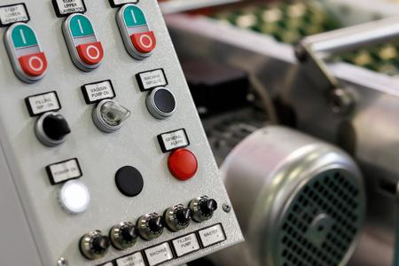 Industrial machine control panel close up. Selective focus.
