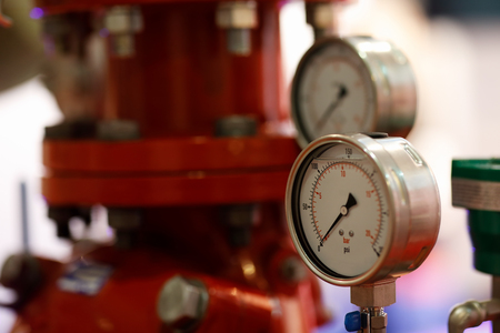 Manometers and pump for fire extinguishing system. Selective focus.