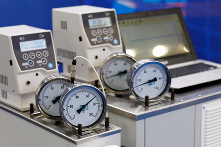 Laboratory equipment with thermometer gauges in the foreground. Selective focus.