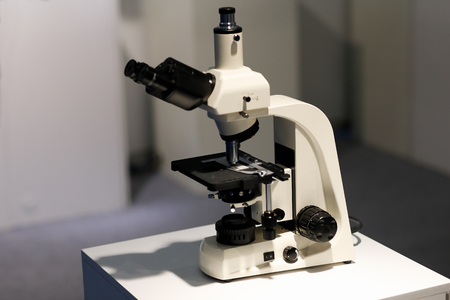 Laboratory microscope with a trinocular head. Selective focus. Фото со стока