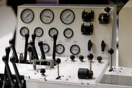 Controls at operation desk of a drilling rig. Selective focus.