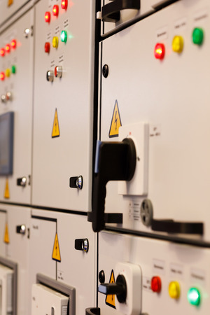 Front panels of industrial electrical control cabinets. Selective focus.