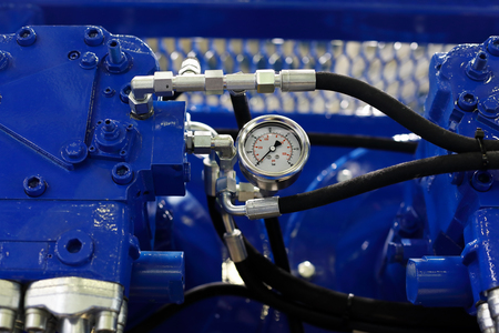 Close up view of air compressor with pressure gauge. Selective focus.