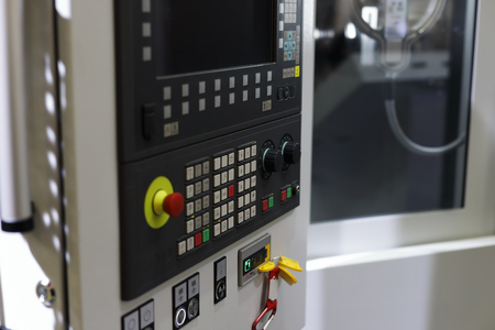 Metalworking machining center with CNC control panel. Selective focus.