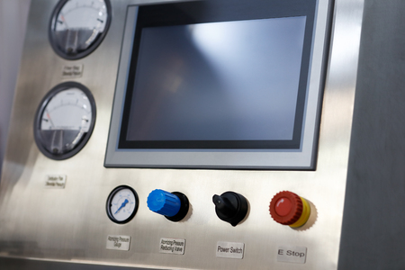 Industrial manufacturing control panel with touch screen. Selective focus.