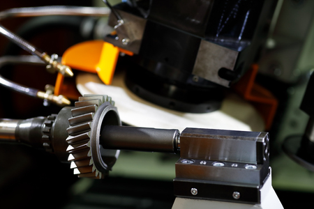 CNC gear form grinding machine. Grinding a gear wheel. Selective focus.