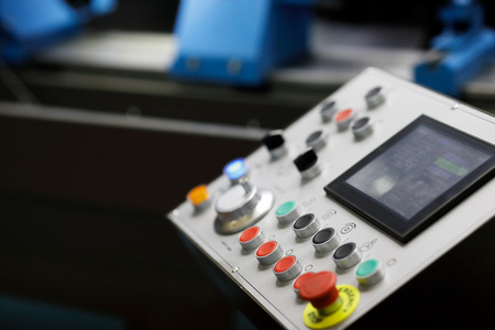 Control panel of modern industrial CNC equipment. Selective focus.