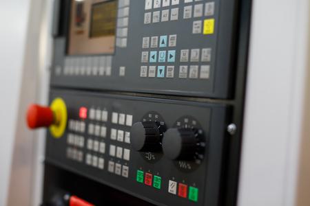 Control panel of modern CNC lathe machine. Selective focus.