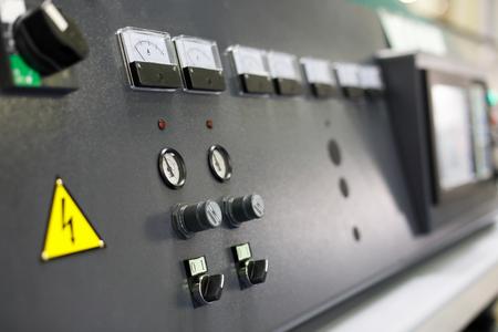 Control panel of modern manufacturing equipment. Selective focus. Фото со стока