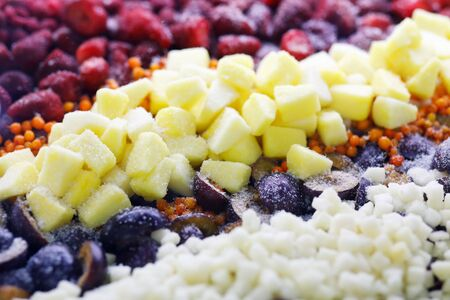 Assorted deep frozen fruits and berries. Selective focus. Фото со стока