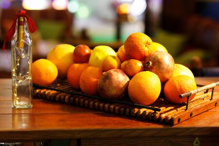 Various fruits on the wooden tray. Selective focus.