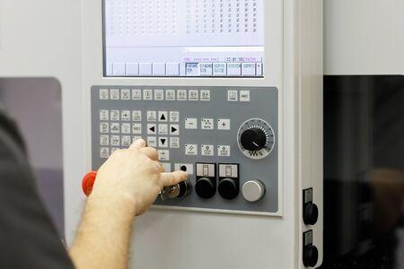 setting up parameters of CNC machining center using control panel Reklamní fotografie