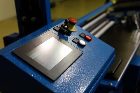 Computer controlled metal sheet bending machine. Selective focus. Reklamní fotografie