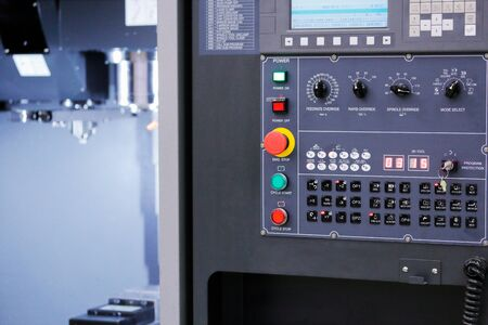 Control panel of CNC vertical milling machine. Selective focus.