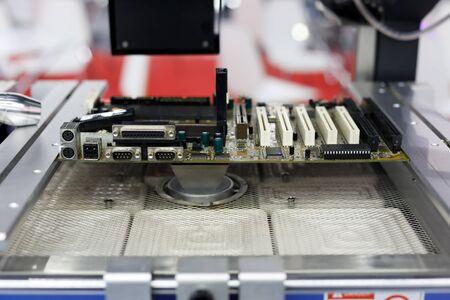 Computer motherboard repair machine with the large heating zone. Selective focus. Reklamní fotografie
