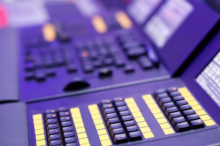 Closeup of playback buttons on lighting control console. Selective focus.