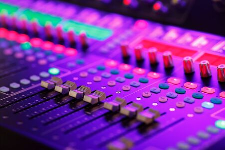 Professional digital audio mixing system at a live event. Selective focus.